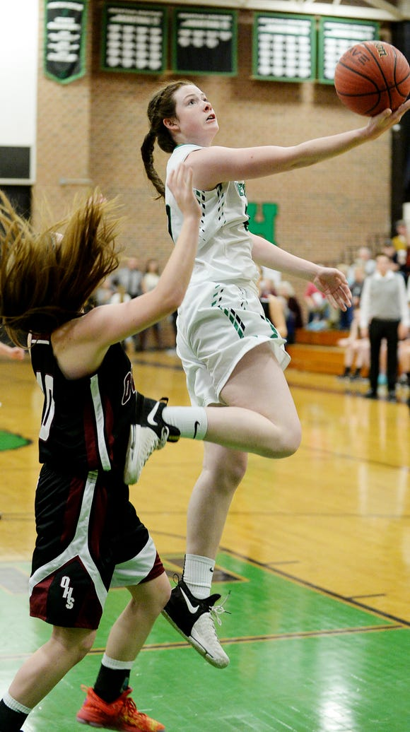 Mountain Heritage's Kylie Robinson shoots a layup in