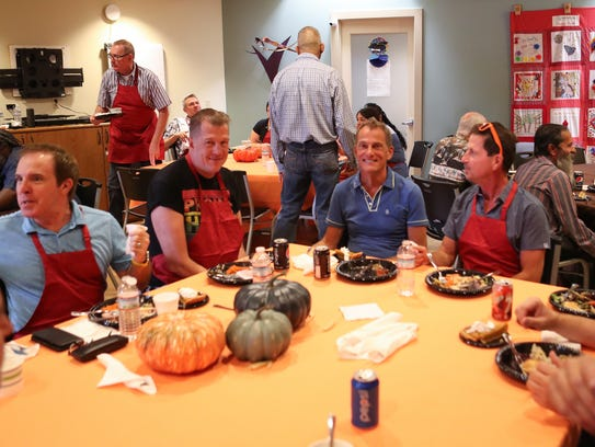 Volunteers and others enjoy the Thanksgiving meal at