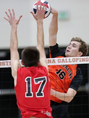 Kaukauna's Ben Brochtrup (16) goes up for a kill against Kimberly's Sam Radtke during a match this season. Both made the all-state team this season.