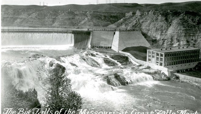 The Big Falls of the Missouri at Great Falls was captured in a WPA photo in the 1930s. The caption noted the hydroelectric dam with water running over spillway, the power lines running over cliffs from power station and the waterfalls in foreground and trees in left foreground.