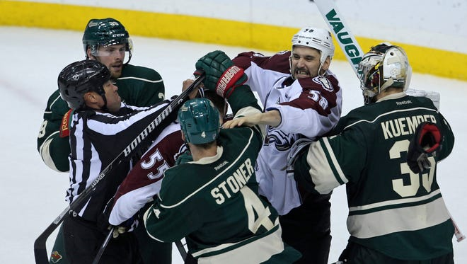 Colorado Avalanche forward Patrick Bordeleau (58) is held back from Minnesota Wild defenseman Clayton Stoner (4) during the third period in game six of the first round.