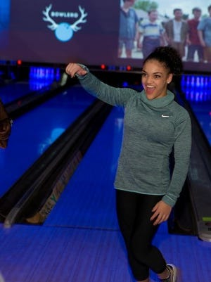Old Bridge Olympian Laurie Hernandez gets a strike on Nov. 12 at the new Bowlero in North Brunswick.