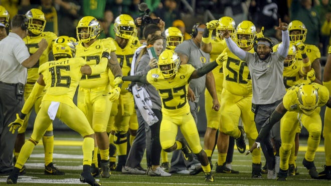 Oregon cornerback Verone McKinley, 23, celebrates an interception against Colorado last season at Autzen Stadium. [Andy Nelson/The Register-Guard] - registerguard.com