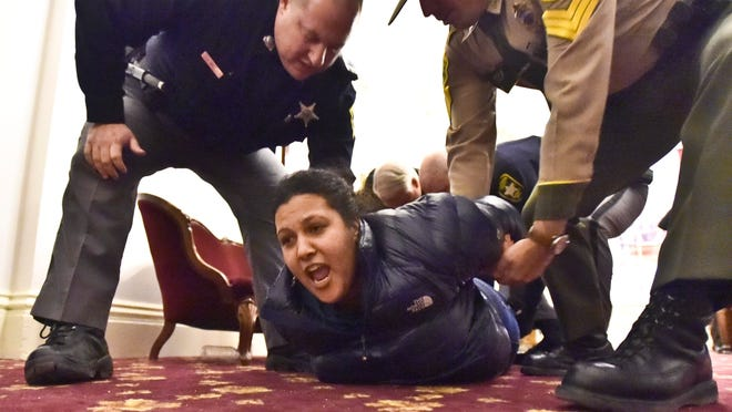 Single-payer protester is arrested after refusing to leave the Statehouse in Montpelier on Thursday.
