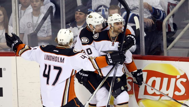 Anaheim Ducks center Andrew Cogliano (7) celebrates his goal with teammates during the second period against the Winnipeg Jets in game four of the first round of the 2015 Stanley Cup Playoffs at MTS Centre.