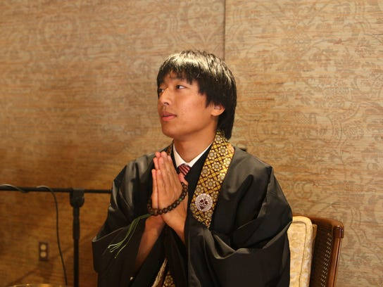 Reverend Yugo Fujita offers a prayer inside the Buddhist