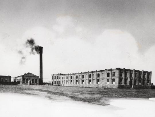 In 1891, a single smokestack puffed smoke from a coal
