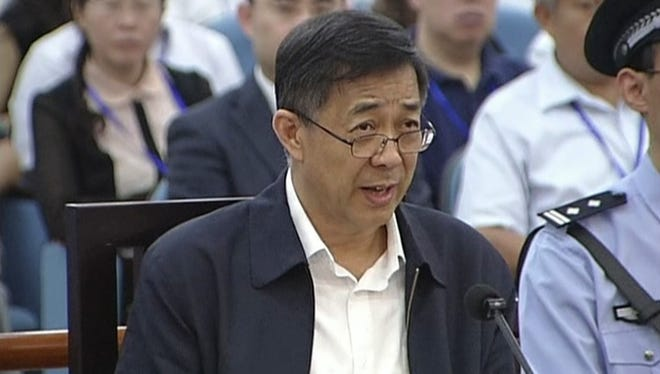 Former Chinese politician Bo Xilai speaks in a courtroom at Jinan Intermediate People's Court in Jinan, eastern China's Shandong province, Sunday.