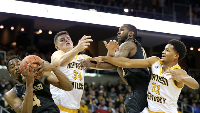 Oakland Golden Grizzlies forward Jalen Hayes (4) pulls down a rebound away from Northern Kentucky Norse forward Drew McDonald (34) in the second half during the NCAA college basketball game between Oakland Golden Grizzlies and the Northern Kentucky Norse, Friday, Jan. 26, 2018, at BB&T Arena in Highland Heights, Kentucky. Oakland won 83-70.