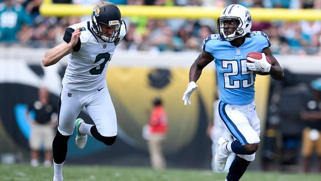 Titans cornerback Adoree' Jackson (25) races up the field with a punt return past Jaguars punter Brad Nortman (3) in the third quarter Sunday, Sept. 17, 2017, at EverBank Field.