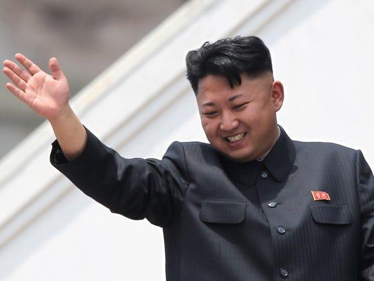 North Korea leader Kim Jong Un, shown in 2013, waves