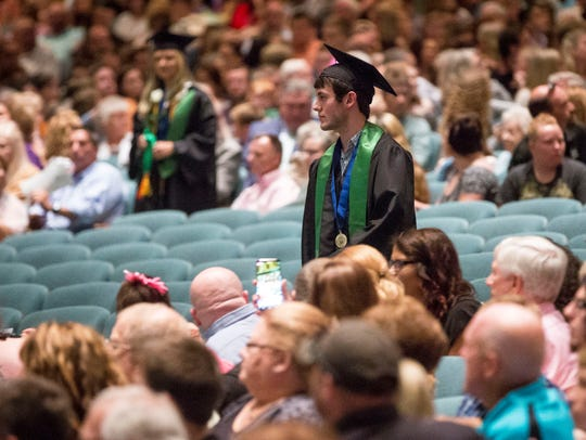 Yorktown High School students walk across the stage
