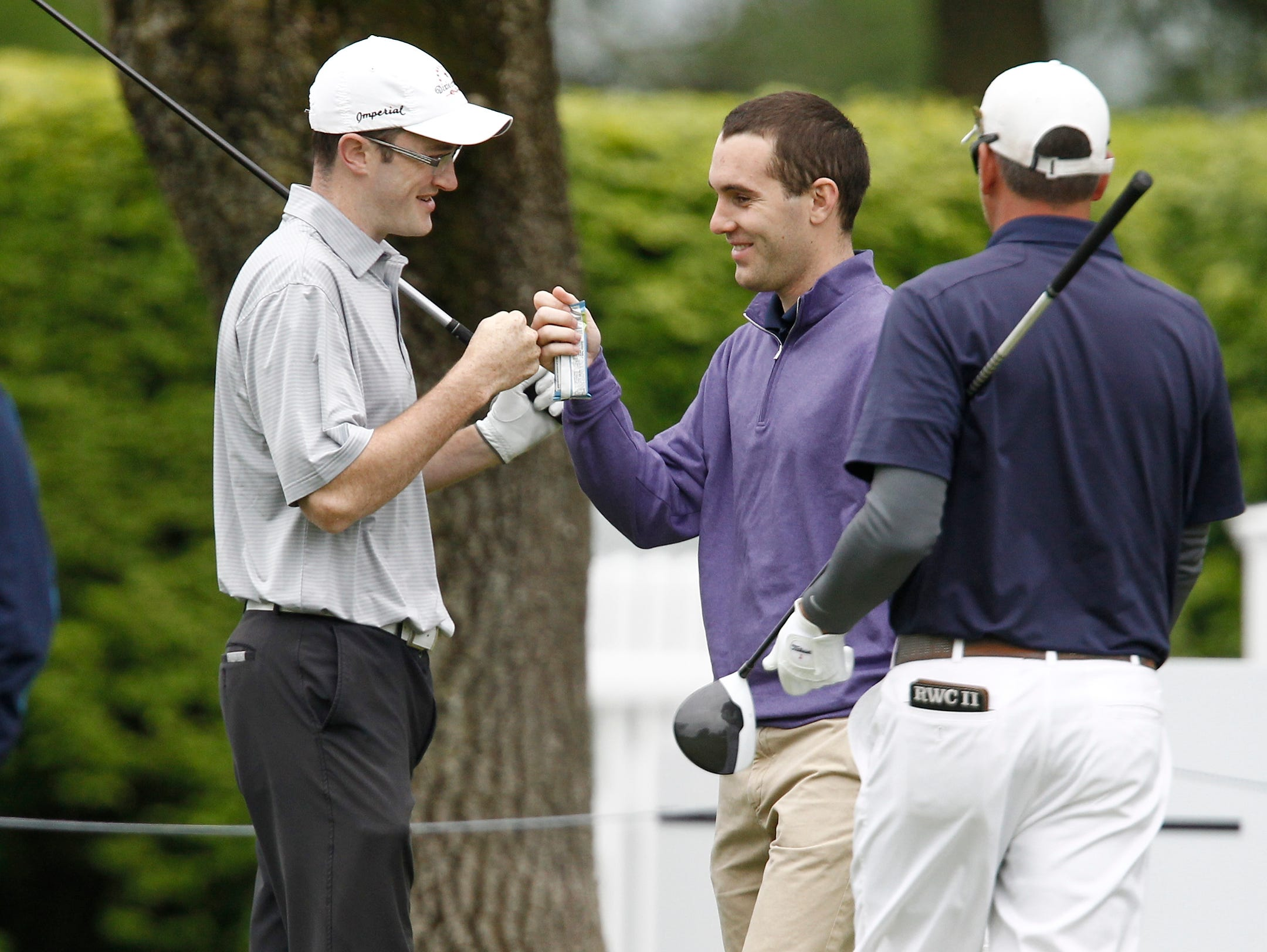 Luke Freehan, left, and Max Christiana fist bump prior to teeing off on the first hole during day 2 of the 2016 U. S. Amateur Four-Ball Championship at Winged Foot Golf Club in Mamaroneck on Sunday, May 22, 2016.