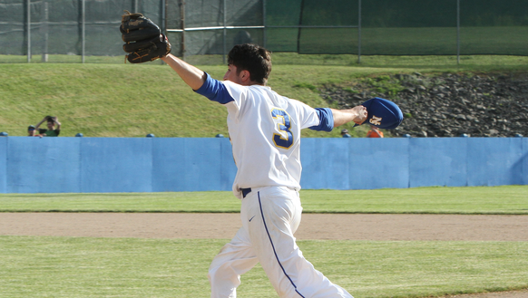 Danny Capra celebrates after catching the final out