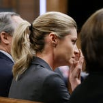 Erin Andrews listens to the verdict in her lawsuit over secretly recorded videos is read March 7, 2016, in Nashville.