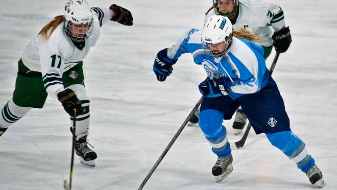 South Burlington's Rachel Pitcher (right) is chased by Rice Memorial's Anna Connerty (left) and Haleigh Byrnes in South Burlington on Thursday, December 11, 2014.