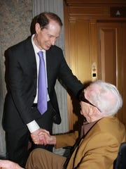 U.S. Sen. Ron Wyden congratulates Bruce Williams of Salem after Williams received the Congressional Gold Medal at a ceremony on Wednesday, May 20, 2015, in Washington D.C.