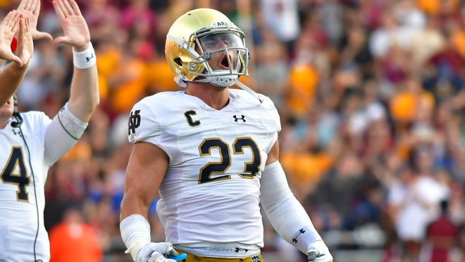 Sep 16, 2017; Chestnut Hill, MA, USA; Notre Dame Fighting Irish linebacker Drue Tranquill (23) celebrates in the third quarter against the Boston College Eagles at Alumni Stadium. Mandatory Credit: Matt Cashore-USA TODAY Sports