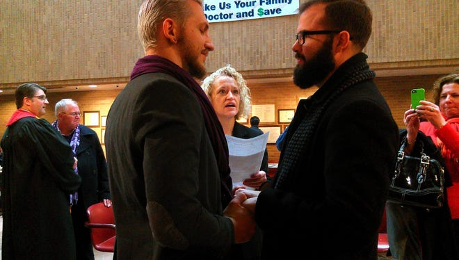 Retired Utah state legislator Jackie Biskupski officiates at a wedding in Salt Lake City's county government building on Monday, Dec. 23, 2013.
