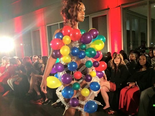 Johnathan Darden, Balloonatic's owner/designer, balloon dresses on the runway at the Baton Rouge Fashion Week. The dress was inspired by a Lady Gaga dress.