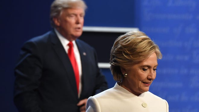 This file photo taken on October 19, 2016 shows  former Democratic nominee Hillary Clinton and former Republican nominee Donald Trump walking off the stage after the final presidential debate at the Thomas & Mack Center on the campus of the University of Las Vegas in Las Vegas, Nevada.