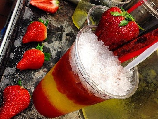 Raspado is a traditional Mexican treat of sweetened shaved ice, fresh fruit, often topped with sweetened condensed milk .