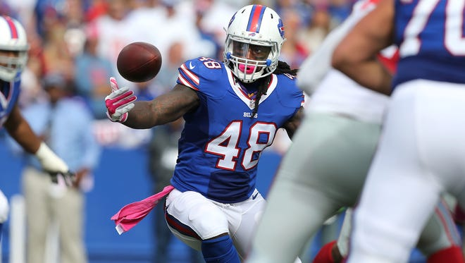 Bills TE MarQueis Gray bobbles the ball after a catching a short pass.  He held on for a short gain.