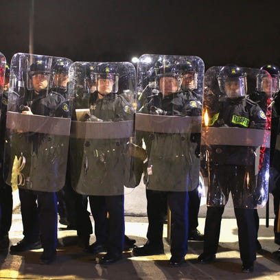 Officers guard the Ferguson (Mo.) Police Department