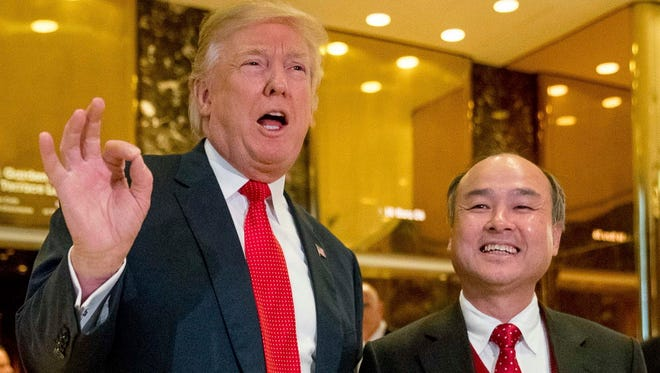 """President-elect Donald Trump, left, with SoftBank CEO Masayoshi Son at Trump Tower on Dec. 6. Trump last week gave himself kudos for creating 8,000 U.S. jobs by Son, saying it was proof of """"the spirit and the hope"""" stirred by his presidential win. But for those particular jobs, Trump was basically taking a bow for the second time."""