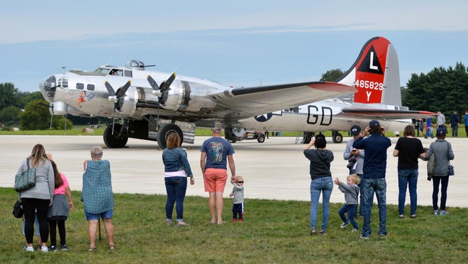 Crowds gather around the Yankee Lady, a B-17 Flying Fortess that was on display at last year's Patriot's Day Fly-In. This year's event has been canceled, event organizers announced. Sam Fry/Daily News File Photo