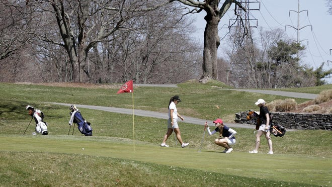 Golfers compete in the Brown Bear Spring Invitational at Metacomet Country Club in 2015.