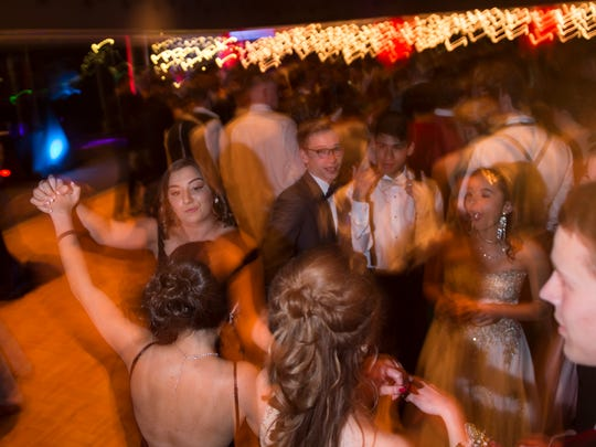 North students dance during their prom at Old National Events Plaza on Saturday, April 21, 2018.