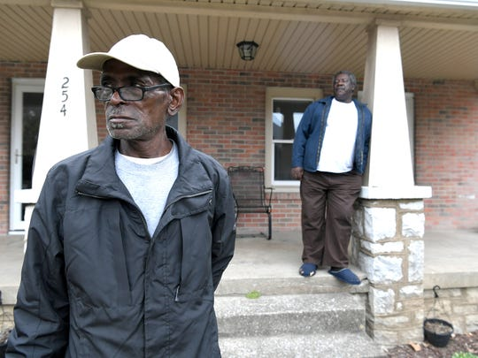 Dwayne McCord,left, and Joe Rucker stands outside Franklin Community House on Natchez Street in Franklin on Nov. 14, 2017. They are both residents of a new men's group home thats started in Sep. 2017 by pastor Kevin Riggs to help men find transitional housing in Franklin.