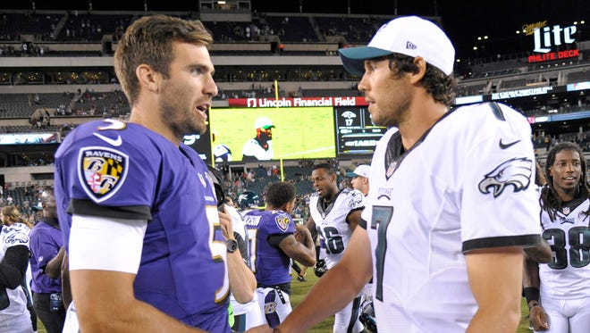 The Ravens' Joe Flacco (left) and the Eagles' Sam Bradford just got sweet deals.