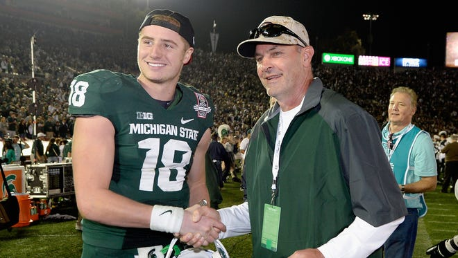 Kirk Gibson, right, poses with Michigan State quarterback Connor Cook after a win over the Stanford Cardinal in the 100th Rose Bowl Game on Jan. 1, 2014, in Pasadena, California.