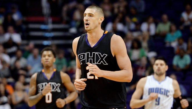 Mar 17, 2017; Phoenix, AZ, USA; Phoenix Suns center Alex Len (21) runs up the court in the first half of the NBA game against the Orlando Magic at Talking Stick Resort Arena.