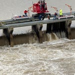 Workers with the U.S. Army Corps of engineers pull wooden pins to drain water Sunday from the Mississippi River into the Bonnet Carre Spillway in Norco, La. The Mississippi River water levels are rising because of heavy December rain in the Midwest. The opening of the Bonnet Carre Spillway helps relieve pressure on New Orleans-area levees by making sure the water doesn''t flow faster than 1.25 million cubic feet per second through the city.