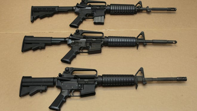 Three variations of the AR-15 assault rifle are displayed at the California Department of Justice in Sacramento FILE -- In this Aug. 15, 2012 file photo, three variations of the AR-15 assault rifle are displayed at the California Department of Justice in Sacramento, Calif. While the guns look similar, the bottom version is illegal in California because of its quick reload capabilities. Omar Mateen used an AR-15 that he purchased legally when he killed 49 people in an Orlando nightclub over the weekend President Barack Obama and other gun control advocates have repeatedly called for reinstating a federal ban on semi-automatic assault weapons that expired in 2004, but have been thwarted by Republicans in Congress. (AP Photo/Rich Pedroncelli,file)
