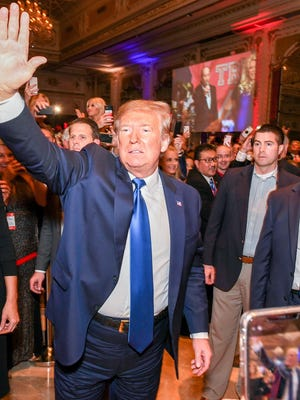 President Donald Trump greets guests at The Trumpettes Red, White and Blue Celebration at Mar-a-Lago on Feb. 1, 2020.