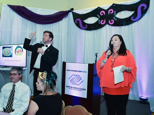 Auctioneers SLC County Commissioner Tod Mowery and SLC Chamber President Terissa Aronson didi their best to get the highest bids.