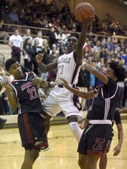 Henderson County's De'Angelo Ware drives to the basket