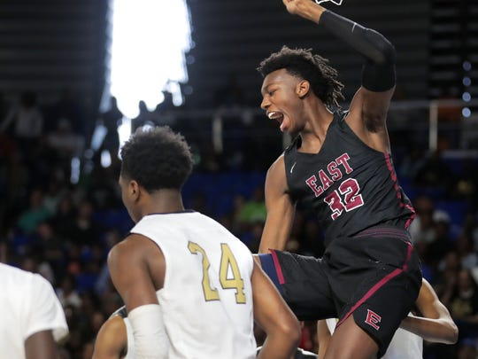 James Wiseman (32) from Memphis East scores against