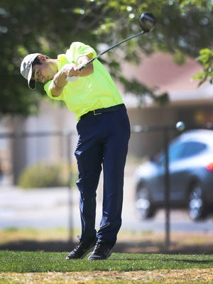 Eastwood's Michael Salazar tees off on the 17th hole Tuesday.