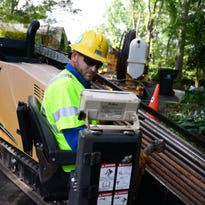 Duke Energy contractor Michael Duncan works on a residential undergrounding project near Cleveland Park. The city and Duke Energy have a partnership to fund service line burials for homeowners.