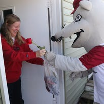 Connie Jacobson, left, receives a Wisconsin Rapids Rafters Valentines gift package from mascot Roscoe P. Rafter at her home in Wisconsin Rapids, Friday, Feb. 12, 2016. The surprise visit from Roscoe was a gift from Jacobson's boyfriend, Jim Brown.