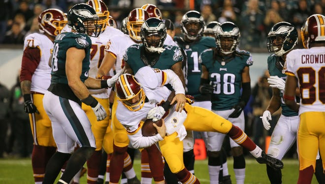 Eagles safety Malcom Jenkins tackles Washington quarterback Kirk Cousins to end the first half at Lincoln Financial Field Saturday.