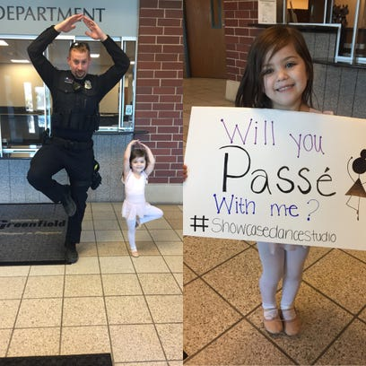 Camera captures Greenfield police officer trying ballet move with girl