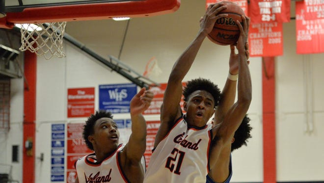 Oakland's TaVon Delk (21) grabs a rebound over teammate Mike Hayworth during the Patriots 44-33 win over La Vergne on Tuesday.