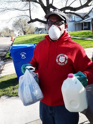 Kewanee Salvation Army Director Eddie Toliver, shown here in a file photo delivering food to a family need, says the area's need this year has never been greater as families continue to grapple with the economic effects of the pandemic.