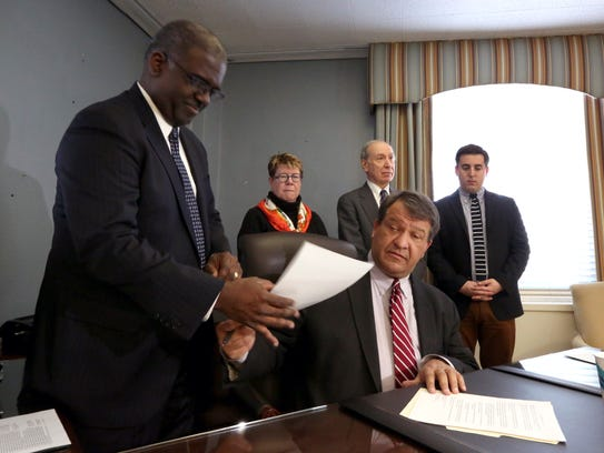 Westchester County Executive George Latimer signs executive